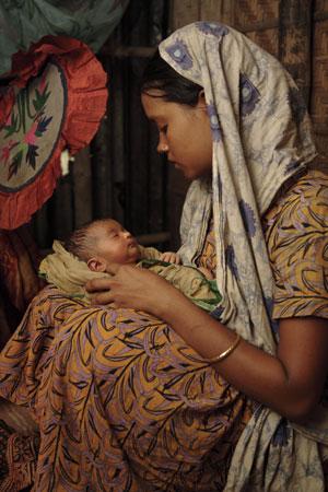 A Bangladeshi woman and her newborn.